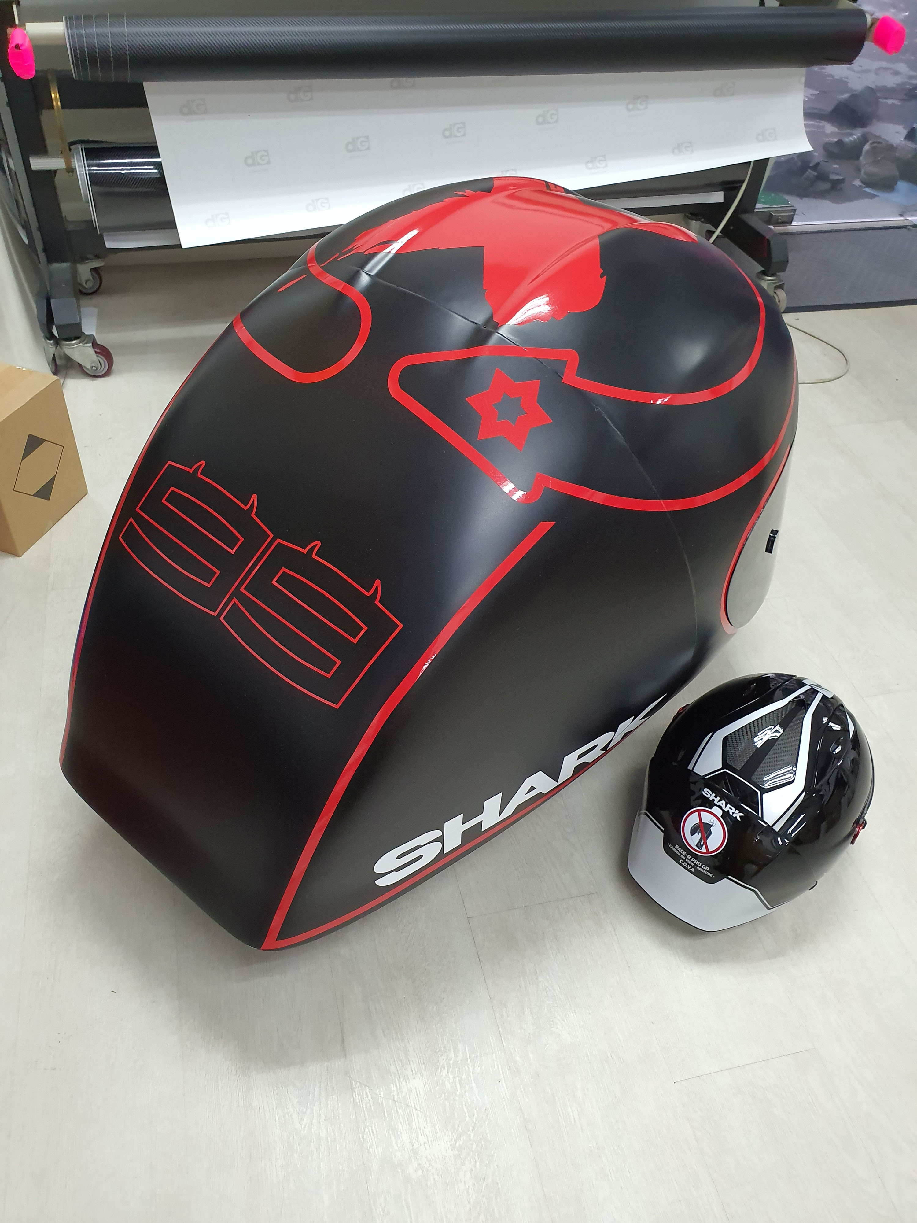 Top view of the Gigantic Shark Helmet Decal. Beside it is a normal helmet to see the vast difference in size!