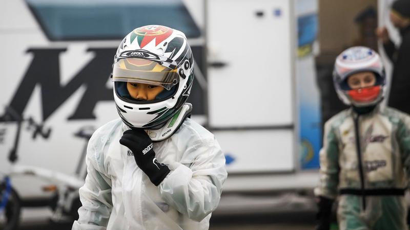 Young Emiliano Cyrus in full Kart-racing gear with Juzz Wheelzz Custom Design Arai Head Gear in Adria