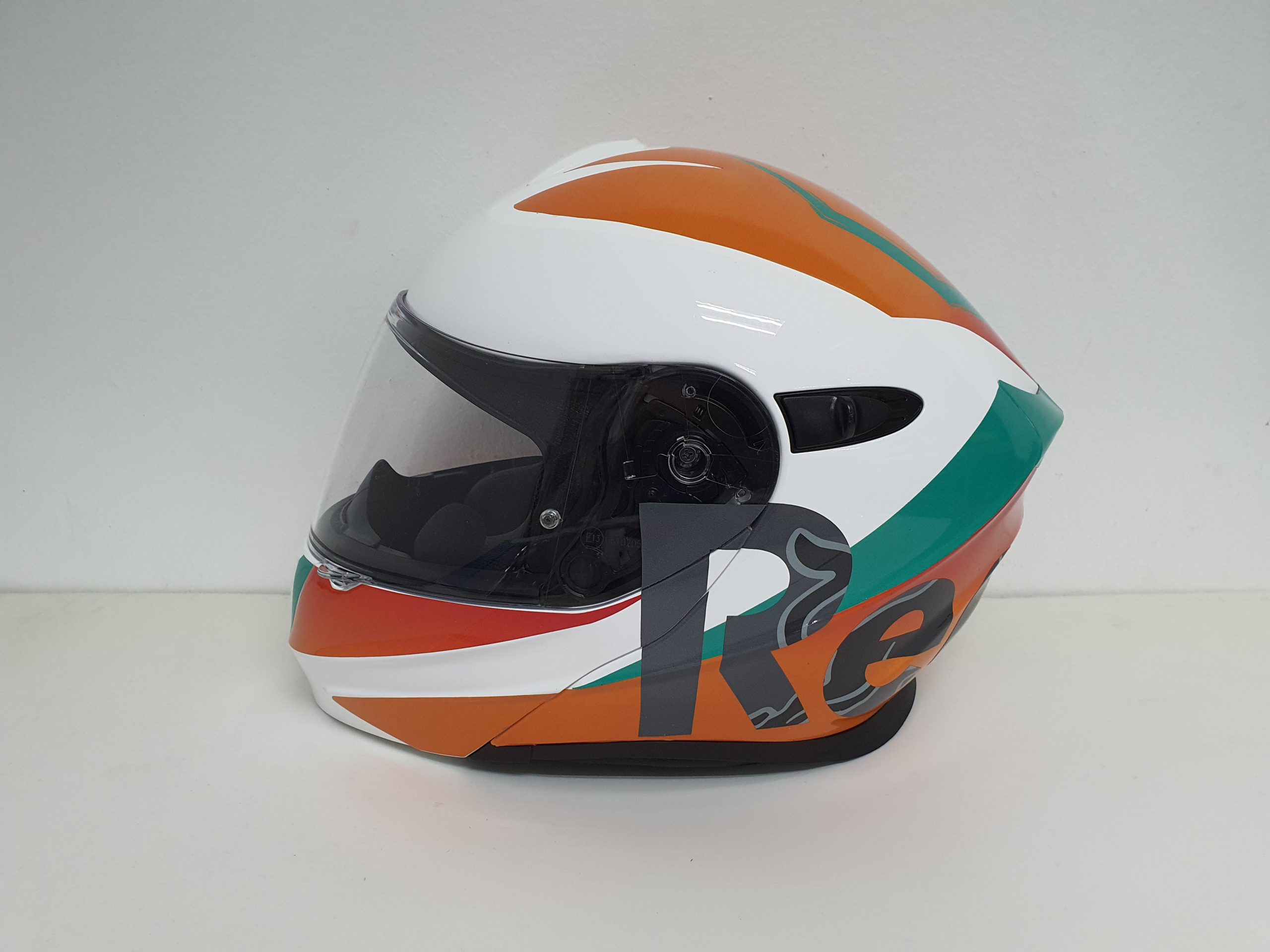 "The Side Profile of the Motorbike headgear with ""Red"" on its left and the ""R"" slightly touching the front"